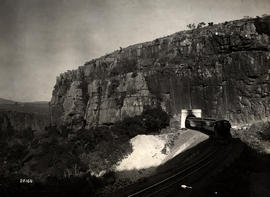 Waterval-Boven. Train emerging from tunnel on the left-hand bank of the Elands River.