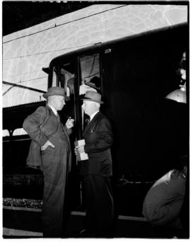 Durban, 24 November 1955. Minister Schoeman in conversation outside electrical locomotive.