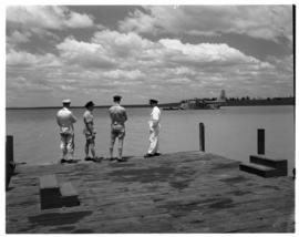 Vaal Dam, circa 1949. Arrival of BOAC flying boat Solent G-AKNS. Men on jetty with aircraft in th...