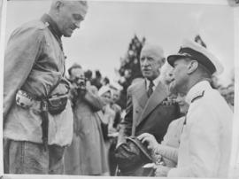 Pretoria, 29 March 1947. King George VI speaks to miiltary veteran at Louis Botha statue.