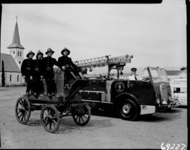 Worcester, 1960. Fire brigade posing at old fire truck from 1877.
