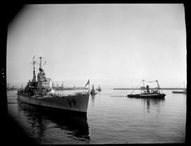 Cape Town, 17 February 1947. 'HMS Vanguard' in Table Bay with SAR tugs in attendance.