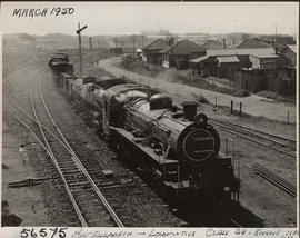 Port Elizabeth, 1950. SAR Class 24 with freight train.