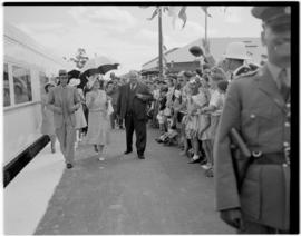 King George VI and Queen Elizabeth welcomed on station platform.