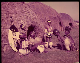Zululand. Men and boys at traditional hut.