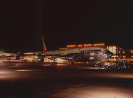 Johannesburg, 1970. Jan Smuts Airport. SAA Boeing 707 ZS-SAI 'East London' on  apron at night.