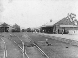 Cookhouse, 1897. Train in station.