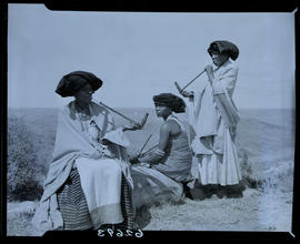 Transkei, 1954. Three women smoking pipes.