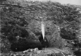 Hex River Mountains, 1895. Cape 4th Class Stephensons  locomotive emerging from tunnel. (EH Short)