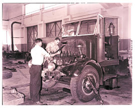 """Kimberley, 1942. Mechanics at work in SAR Road Transport Services workshops."""