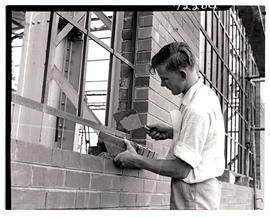 """Pretoria, 1962. Apprentice bricklayer at SAR workshops at Koedoespoort."""