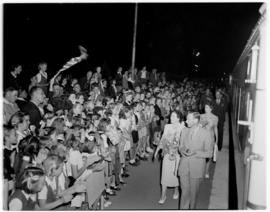 Ficksburg, 12 March 1947. Royal Family walking past welcoming crowds.