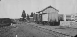 Kleinpoort, 1895. Goods wagons at loading ramp. (EH Short)