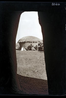 Transkei, 1932. Group of the Bomvaan tribe outside hut.