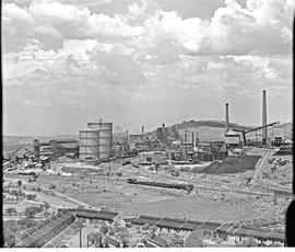 Pretoria, 1946. View of Iscor steel plant with SAR Class 19D hauling freight train in foreground.