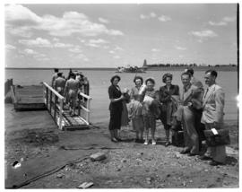 Vaal Dam, circa 1949. Arrival of BOAC flying boat Solent G-AKNS. Passengers next to jetty.