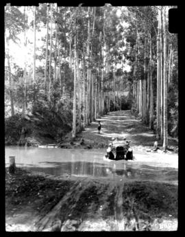 Round in Nine Tours - motor car fording river.