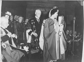 Cape Town, 22 April 1947. Queen Elizabeth is robed on receipt of honorary doctorate from Universi...