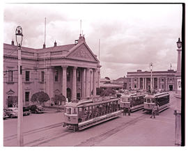 """Kimberley, 1938. Trams at City Hall and Market Square."""