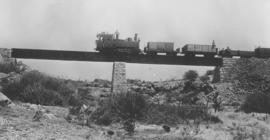 South-West Africa. DSWA Class Ha No 29 with construction train on bridge between Grootfontein and...