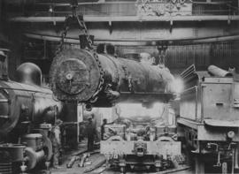 Pretoria, 1958. Mallett boiler on sling in locomotive workshop.