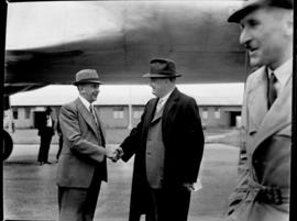 Arrival of Avro York ZS-ATR 'Impala', interior, man greeting Minister Ben Schoeman outside aircr...