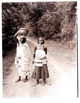 Transkei, 1940. Two women in road.