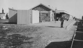 Belmont, 1895. Station building with railwayman posing in the foreground. (EH Short)