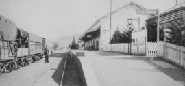 Matjiesfontein, 1895. Train at station building and platform. (EH Short)
