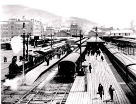 Cape Town, circa 1906. CGR 6th Class about to leave with passenger train.