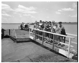 Vaal Dam, circa 1949. Arrival of BOAC flying boat Solent G-AKNS. Passengers on gangplank from jetty.