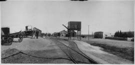 Victoria West (later Hutchinson), 1895. Station in background with ox wagons in the foreground. (...