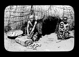 Three black people at traditional home.