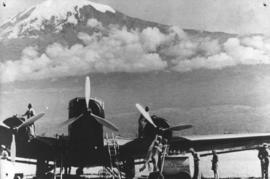SAA Junkers JU-52 taking fuel with snow-capped peak in the background.