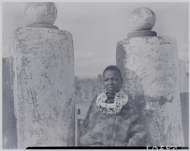 Pretoria district, 1952. Ndebele kraal, boy leaning on column.