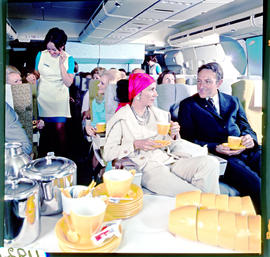 SAA Boeing 747 interior, passengers having tea.