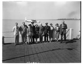 Vaal Dam, circa 1948. BOAC Solent flying boat G-AKCR 'Saint Andrew'. Group posing on jetty with a...