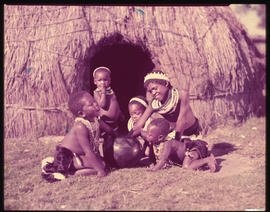 Zululand. Children at traditional hut.