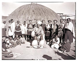 Natal, 1946. Zulu chief with his wives and children in front of hut.