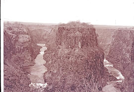 Victoria Falls, Rhodesia. Bend in the Zambezi River gorge with Victoria Falls raiway bridge in th...