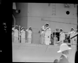 Cape Town, 17 February 1947. Farewell salute by King George VI as he is piped ashore from 'H...