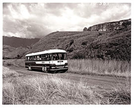 """Drakensberg, 1966. SAR MT16937 motor coach on country road."""