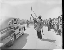 Port Elizabeth, 27 February 1947. Royal family in open car given a traditional greeting as they p...