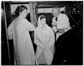 Swellendam, 22 February 1947. Princesses Elizabeth and Margaret with the locomotive inspector on ...