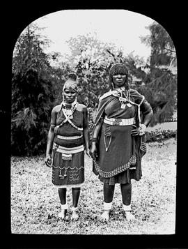 Two black women in traditional dress.