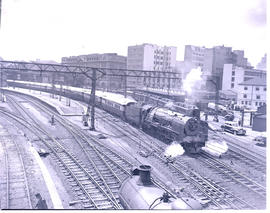 Johannesburg, 1946. SAR Class 15F departing Park Station with Blue Train.
