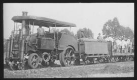 Roadrail tractor with passengers with SAR type 4-T-1 water wagon.