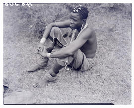 Transkei, 1940. Young man sitting on ground.