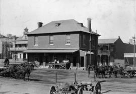 Johannesburg. Kazerne, double storey building with animal-drawn wagons outside and custom house i...