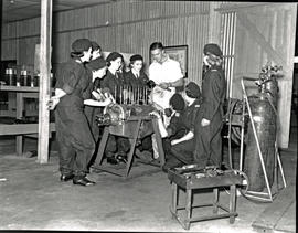 Johannesburg, 1939. Baragwanath airport. Female mechanics of the Women's Aviation Association und...